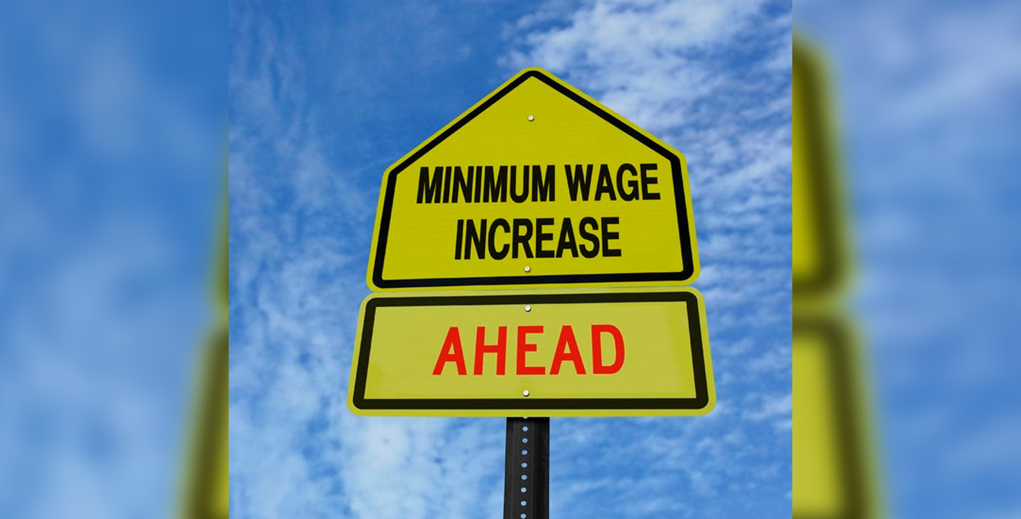 Road sign stating 'minimum wage increase ahead'