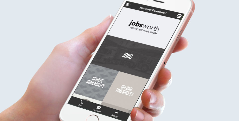 Mobile in hand with Jobsworth app on screen