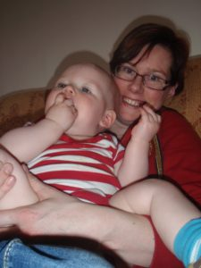 Lucy and her baby son playing on the sofa