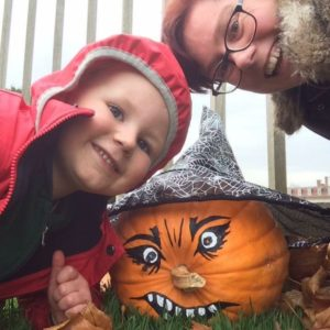 Lucy and son with halloween pumpkin